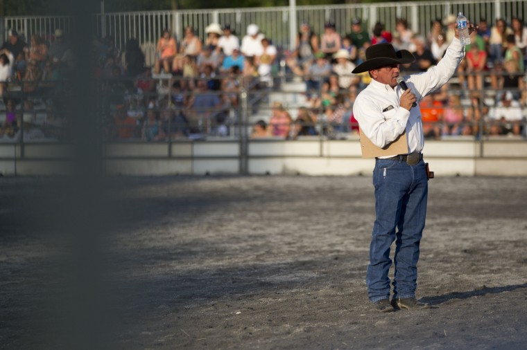 Rockin' R Western Productions owner Chip Ridgely talks to the crowd at the start of the Bull Blast during the 69th Annual Howard County Fair in West Friendship on Monday, August 4, 2014. (Jen Rynda/BSMG)