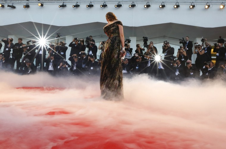 "Italian actress Cristina Capotondi attends the red carpet for the movie ""La Rancon de la gloire"" (The Price of Fame) at the 71st Venice Film Festival August 28, 2014. (Tony Gentile/Reuters)"