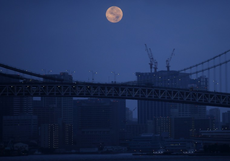 The supermoon is seen over the Rainbow Bridge in Tokyo August 11, 2014. The astronomical event occurs when the moon is closest to the Earth in its orbit, making it appear much larger and brighter than usual. (Toru Hanai/Reuters)