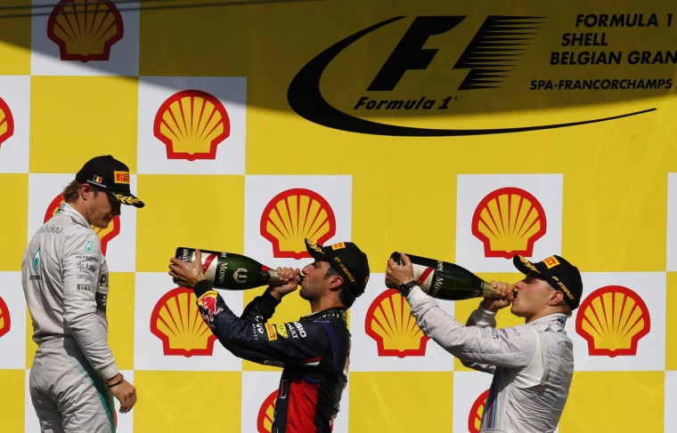 First-placed Red Bull Formula One driver Daniel Ricciardo of Australia (C) and third-placed Williams driver Valtteri Bottas of Finland celebrate with champagne as second-placed Mercedes driver Nico Rosberg of Germany after the Belgian F1 Grand Prix in Spa-Francorchamps August 24, 2014. (Yves Herman/Reuters)