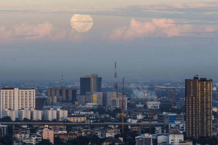 A supermoon is seen over downtown Bangkok August 11, 2014. The astronomical event occurs when the moon is closest to the Earth in its orbit, making it appear much larger and brighter than usual. (Athit Perawongmetha/Reuters)