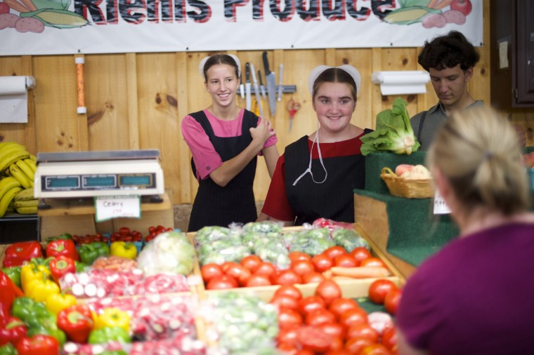 Amish youths wait on customers at a farmer's market produce booth in the village of Bird-in-Hand, Pennsylvania August 9, 2014. (Mark Makela/Reuters)