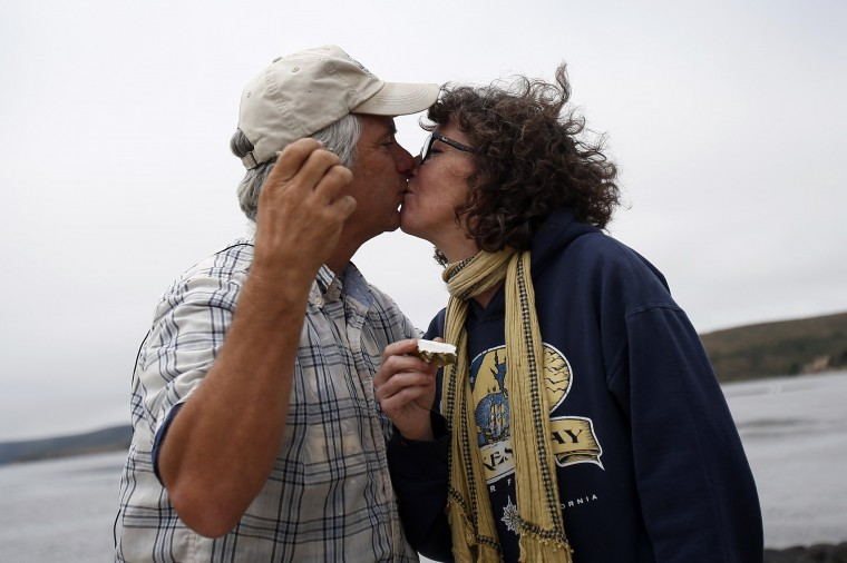 Drakes Bay Oysters Company owner Kevin Lunny kisses his wife Nancy after a toast with oysters during a celebration event at Drakes Bay Oyster Company in Inverness, California July 31, 2014. (Stephen Lam/Reuters)
