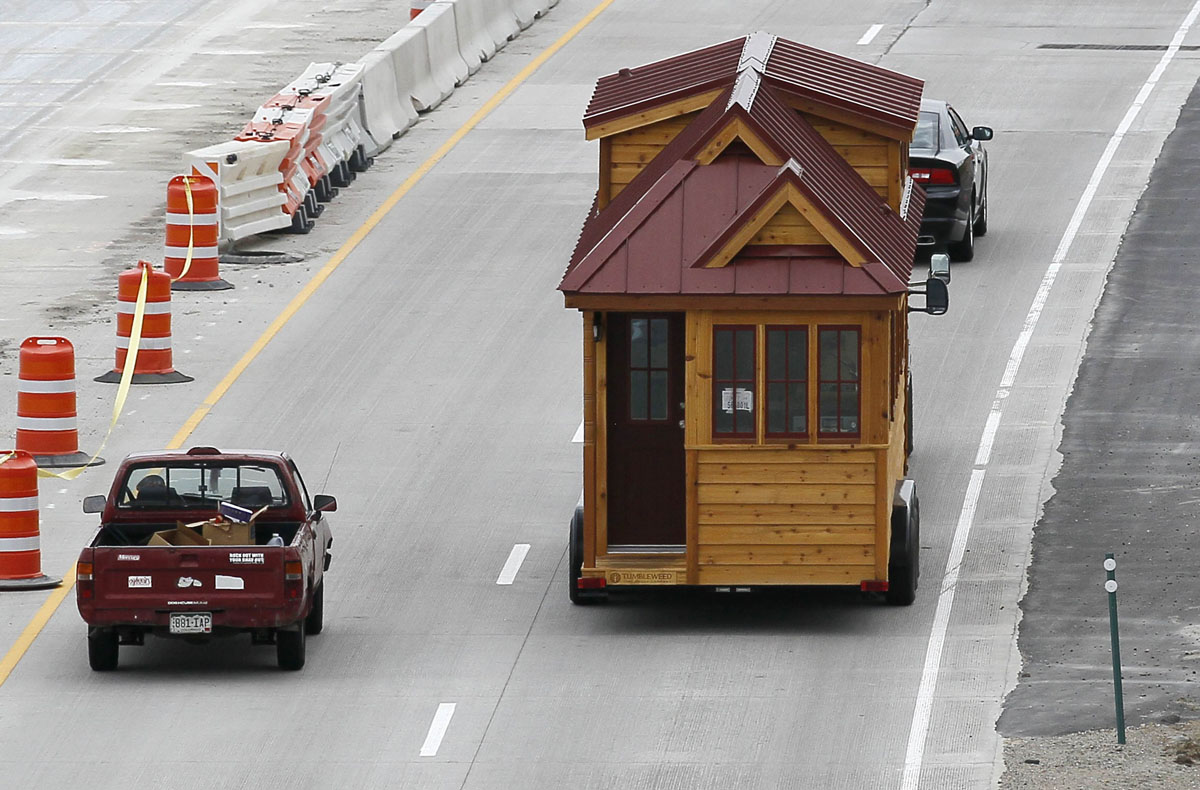 A tumbleweed brand cypress 24 model tiny house is towed for Cypress house