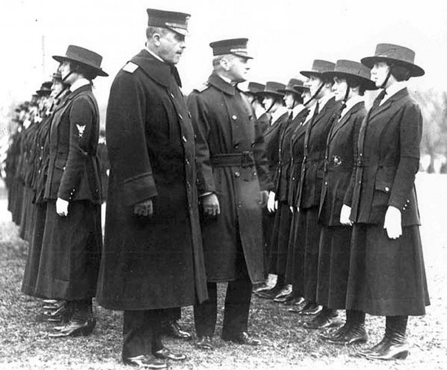"Rear Adm. Victor Blue (left center) chief of the Bureau of Navigation, inspects female yeomen on the grounds of the Washington Monument in a 1918 photo. World War One pioneered many ""firsts"" in technological, scientific and societal innovations. The first officially enlisted women appeared in the U.S. military as the U.S. Navy created a reserve force which allowed enlisted women to work as yeomen, radio operators, nurses, or in other support roles. (REUTERS/Handout via U.S. National Archives)"