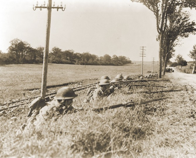 "U.S. soldiers of Company B, 165th Infantry Regiment, 42d Division, await German patrols near Hazavant, France on September 14, 1918. World War One pioneered many ""firsts"" in technological, scientific and societal innovations. Steel helmets were used for the first time as protective headgear for soldiers. (REUTERS/Handout via U.S. National Archives)"