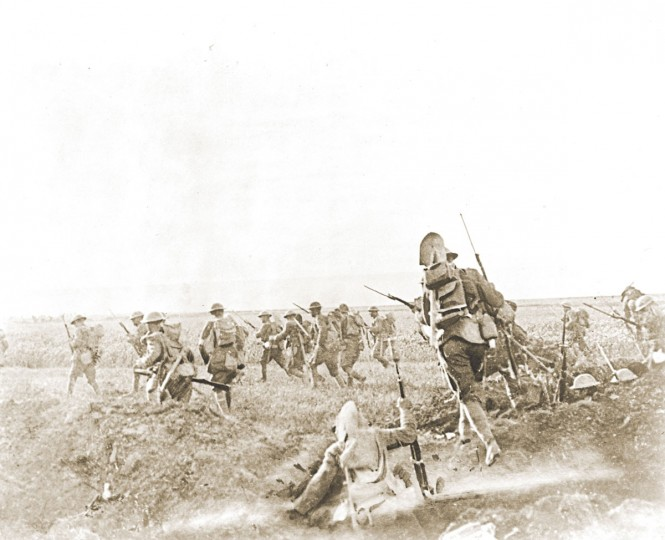 "U.S. soldiers of the 1st Division advance to seize and hold Cantigny, France on May 28, 1918. World War One pioneered many ""firsts"" in technological, scientific and societal innovations. Steel helmets were used for the first time as protective headgear for soldiers. (REUTERS/Handout via U.S. National Archives)"