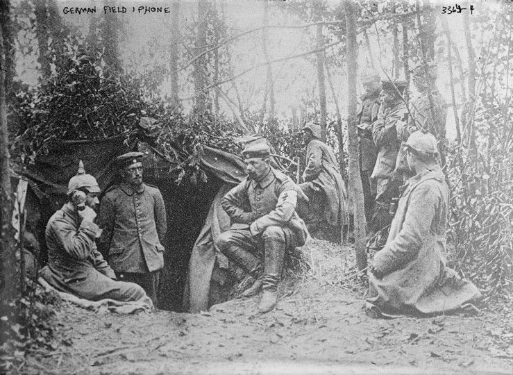 "A photograph shows German soldiers in a dugout during World War One, with a soldier on the left using a field telephone. World War One pioneered many ""firsts"" in technological, scientific and societal innovations. Field telephones and wireless communications were regularly used for the first time to coordinate military movements. (REUTERS/Handout via U.S. Library of Congress)"