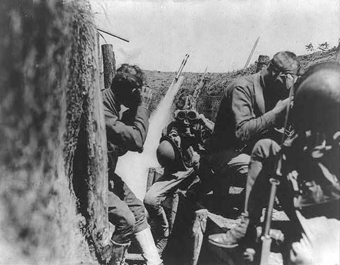 "U.S. soldiers are seen in a trench putting on gas masks in an undated World War One photo. World War One pioneered many ""firsts"" in technological, scientific and societal innovations. Chemical weapons in the form of deadly poison gases were used for the first time, leading quickly to the development of countermeasures like the first gas masks. (REUTERS/Handout via U.S. Library of Congress)"