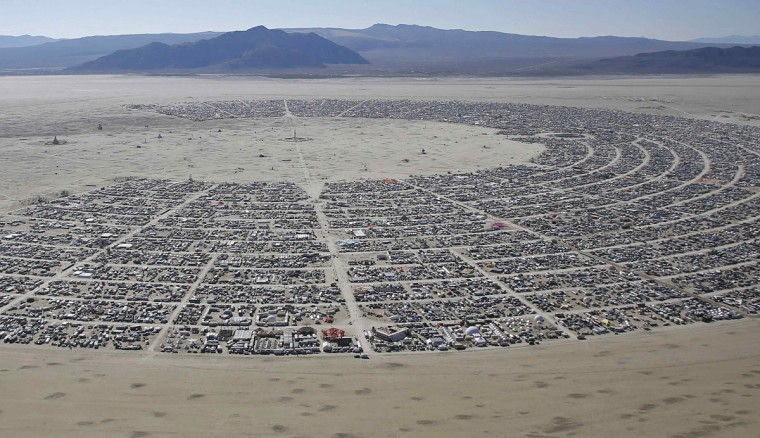 "An aerial view during the Burning Man 2014 ""Caravansary"" arts and music festival in the Black Rock Desert of Nevada August 27, 2014. People from all over the world have gathered at the sold out festival to spend a week in the remote desert cut off from much of the outside world to experience art, music and the unique community that develops. (Jim Urquhart/Reuters)"