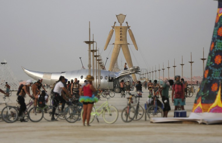 """A view of the Playa and the Man during the Burning Man 2014 """"Caravansary"""" arts and music festival in the Black Rock Desert of Nevada, August 28, 2014. People from all over the world have gathered at the sold out festival to spend a week in the remote desert cut off from much of the outside world to experience art, music and the unique community that develops. Picture taken August 28, 2014. (Jim Urquhart/Reuters)"""