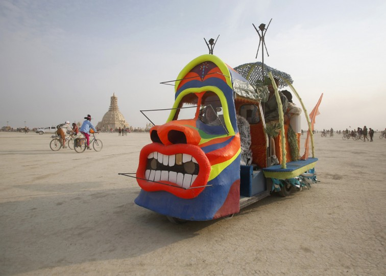 "A mutant vehicle drives across the Playa during the Burning Man 2014 ""Caravansary"" arts and music festival in the Black Rock Desert of Nevada, August 29, 2014. (Jim Urquhart/Reuters)"