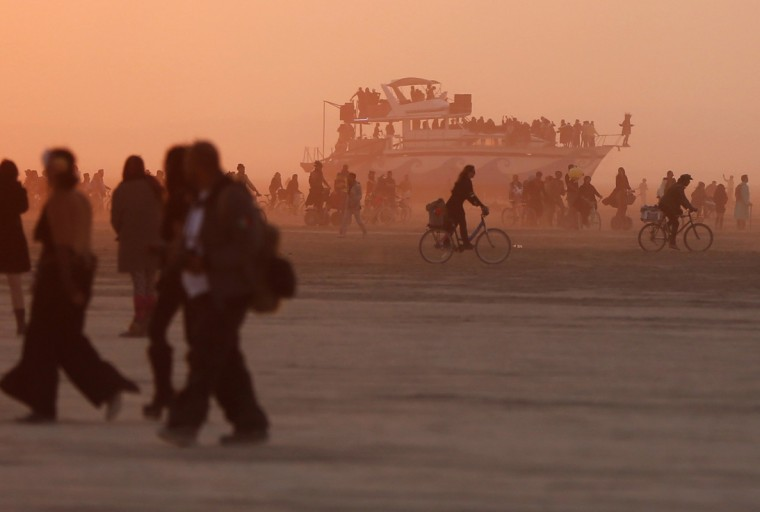 "Mutant vehicles and participants make their way across the Playa during the Burning Man 2014 ""Caravansary"" arts and music festival in the Black Rock Desert of Nevada, August 29, 2014. People from all over the world have gathered at the sold out festival to spend a week in the remote desert cut off from much of the outside world to experience art, music and the unique community that develops. (Jim Urquhart/Reuters)"