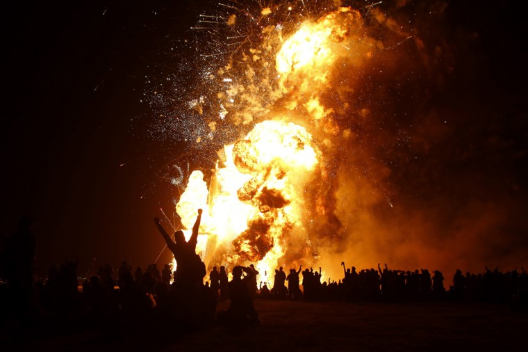 "The Man burns during the Burning Man 2014 ""Caravansary"" arts and music festival in the Black Rock Desert of Nevada, August 30, 2014. (Jim Urquhart/Reuters)"