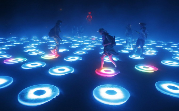 "Participants interact with the art installation The Super Pool during a dust storm at the Burning Man 2014 ""Caravansary"" arts and music festival in the Black Rock Desert of Nevada, August 29, 2014. (Jim Urquhart/Reuters)"