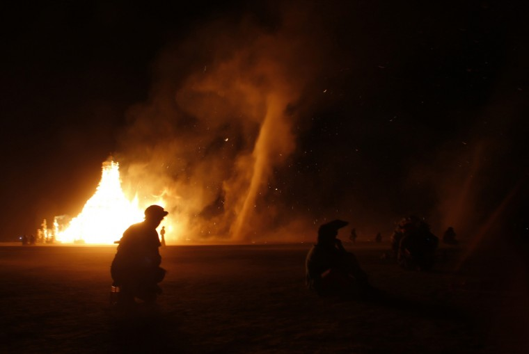 """The Temple of Grace burns on the last day of the Burning Man 2014 """"Caravansary"""" arts and music festival in the Black Rock Desert of Nevada, August 31, 2014. (Jim Urquhart/Reuters)"""
