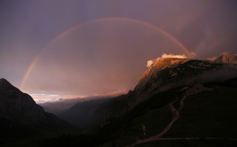 A rainbow spans over the Hohes Goell (L) and Schneibstein mountains near the Carl-von-Stahl-Haus Alpine Club hut in the Berchtesgaden, Bavaria, Alpine region near the Austrian-German border. (Wolfgang Rattay/Reuters)