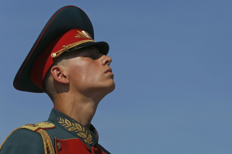 A Russian serviceman takes part in a ceremony to mark the Paratroopers Day in central St. Petersburg. The holiday for the Russian airborne troops has been annually celebrated since the Soviet era till today. (Alexander Demianchuk/Reuters)