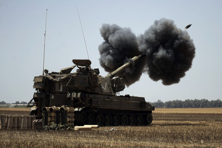 "An Israeli artillery unit fires a 155mm shell towards targets in the Gaza Strip from their position near Israel's border with the Palestinian enclave. The Israeli army informed residents of Beit Lahiya in northern Gaza that it was ""safe"" to return to their homes, as witnesses said troops were seen withdrawing from the area. (David Buimovitch/AFP-Getty Images)"