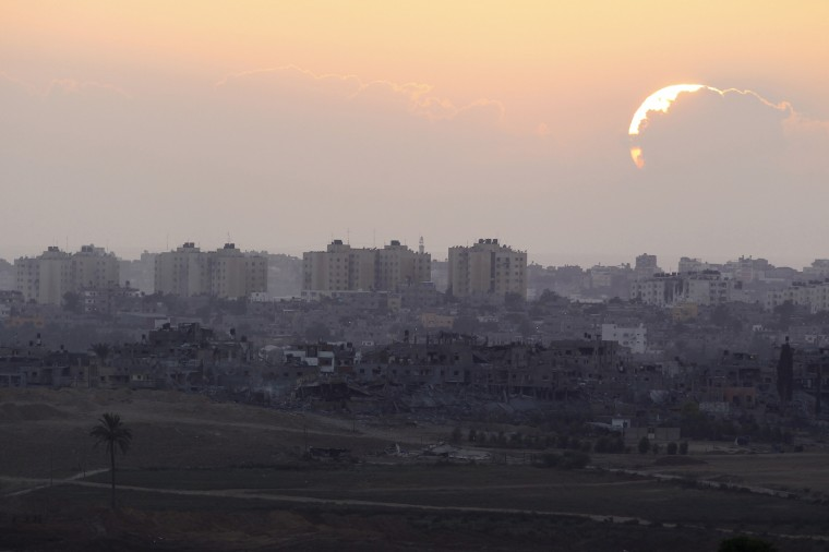 "Sun sets over northern Gaza Strip as seen from the Israeli border. Israeli Prime Minister Benjamin Netanyahu threatened on Saturday to exact an ""intolerable price"" from the Gaza Strip's dominant Hamas Islamists should there be continued attacks from the Palestinian territory. Shelling exchanges continued, pushing the Gaza death toll given by Palestinian officials up to 1,669, but in some areas witnesses reported Israeli tanks pulling back toward the border. Israel said Palestinians launched 74 rockets across the border, most of which fell harmlessly wide while seven were shot down by its Iron Dome interceptor, including over Tel Aviv. (Amir Cohen/Reuters)"