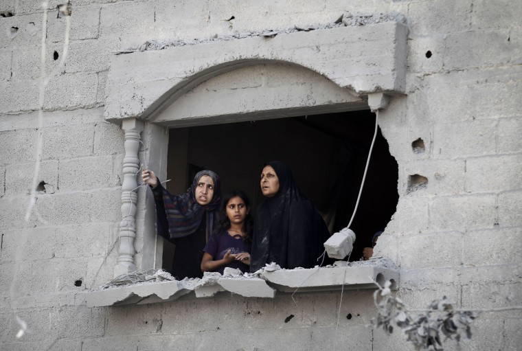 Palestinians look at the wreckage from a damaged window following an Israeli strike, in Rafah, in the southern Gaza Strip. A fresh wave of violence killed dozens in Gaza after the collapse of a UN and US backed ceasefire, officials said, as Hamas denied it kidnapped an Israeli soldier. (Said Khatib/AFP-Getty Images)