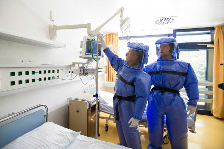 Ward physician Thomas Klotzkowski (L) and doctor for tropical medicine Florian Steiner wearing protective suits, stand in a sick unit at the quarantine station for patients with infectious diseases at the Charite hospital in Berlin August 11, 2014. (Thomas Peter/Reuters)