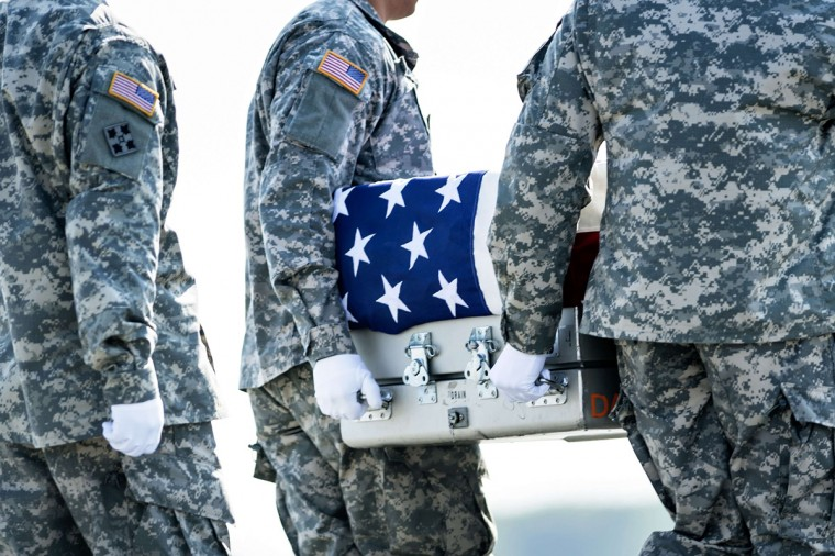 A US Army carry team moves a transfer case with the remains of US Army Maj. Gen. Harold J. Greene from a C-17 cargo plane during a dignified transfer at Dover Air Force Base August 7, 2014 in Delaware. Major General Harold J. Greene was shot dead on August 5, 2014 at a training center in Kabul in an attack that left more than a dozen others wounded, including a senior German officer. (Brendan Smialowski/AFP/Getty Images)