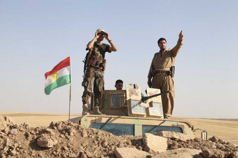 "Kurdish peshmerga troops participate in an intensive security deployment against Islamic State militants on the front line in Khazer on August 8, 2014. U.S. warplanes bombed Islamist fighters marching on Iraq's Kurdish capital on Friday after President Barack Obama said Washington must act to prevent ""genocide"". (REUTERS/Azad Lashkari)"