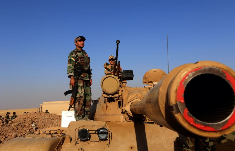 Iraqi Kurdish Peshmerga fighters take position on a tank on the front line in Khazer, near the Kurdish checkpoint of Aski kalak, 40 km West of Arbil, the capital of the autonomous Kurdish region of northern Iraq, on August 8, 2014. A spokesman for the Kurdish peshmerga force said US warplanes bombed Islamic State jihadist targets in two areas of northern Iraq. (SAFIN HAMED/AFP/Getty Images)