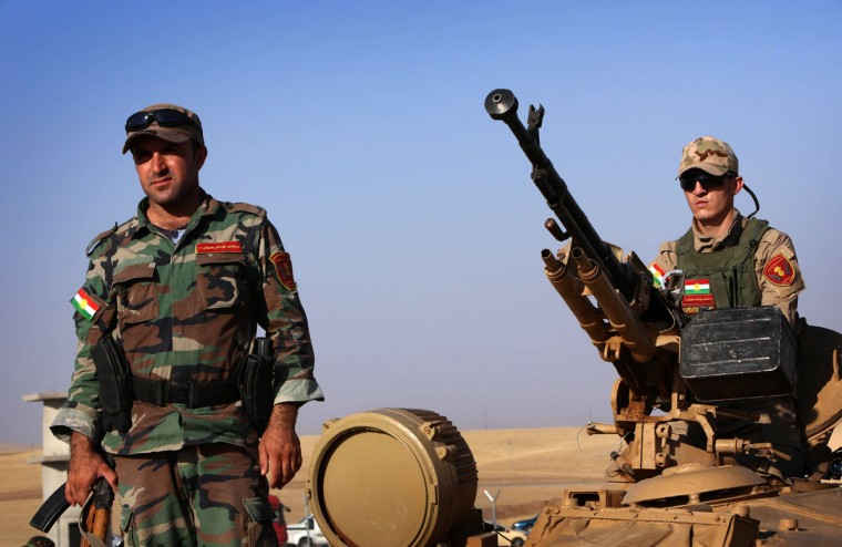 Iraqi Kurdish Peshmerga fighters take position on the front line in Khazer, near the Kurdish checkpoint of Aski kalak, 40 km West of Arbil, the capital of the autonomous Kurdish region of northern Iraq, on August 8, 2014. A spokesman for the Kurdish peshmerga force said US warplanes bombed Islamic State jihadist targets in two areas of northern Iraq. (SAFIN HAMED/AFP/Getty Images)