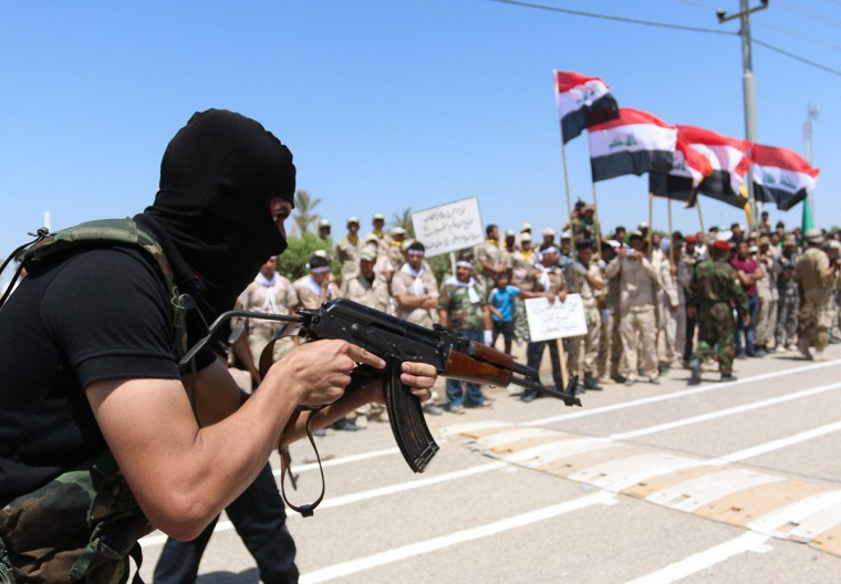 Iraqi Shiite volunteers who have joined government forces to fight Sunni jihadists from the Islamic State (IS) take part in a training session near the southern port city of Basra on August 7, 2014. A UN statement said some reports put the number of people forced to flee by the IS takeover at 200,000. (HAIDAR MOHAMMED ALI/AFP/Getty Images)
