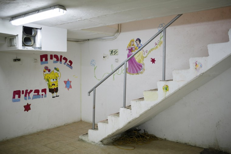 Decorations on walls are seen at the entrance to a bomb shelter in the Israeli southern city of Ashkelon July 31, 2014. Israel declared a Gaza ceasefire over on Friday, saying Hamas militants breached the truce soon after it came in effect and apparently captured an Israeli officer while killing two other soldiers. The 72-hour break announced by U.S. Secretary of State John Kerry and U.N. Secretary-General Ban Ki-moon was the most ambitious attempt so far to end more than three weeks of fighting, and followed mounting international alarm over a rising Palestinian civilian death toll. Picture taken July 31, 2014. (Amir Cohen/Reutrs)
