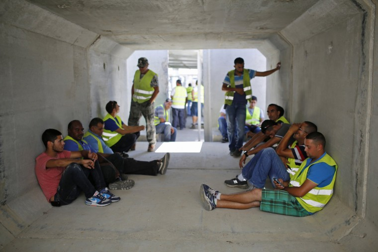 Israeli truck drivers wait inside a bomb shelter at Kerem Shalom crossing August 1, 2014. Israel declared a Gaza ceasefire over on Friday and killed more than 50 Palestinians in renewed shelling, saying militants had breached the truce shortly after it began and apparently captured an Israeli soldier. The 72-hour break announced by U.S. Secretary of State John Kerry and U.N. Secretary-General Ban Ki-moon was the most ambitious attempt so far to end more than three weeks of fighting, and followed mounting international alarm over a rising Palestinian civilian death toll. (Amir Cohen/Reutrs)