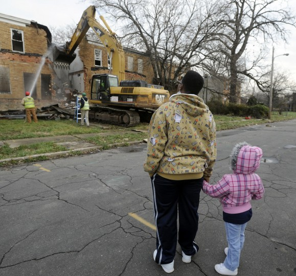 Dorothy O'Bannon and her daughter Labree O'Bannon, 4, watch the demolition of the 4900 block of Denmore Avenue in the Park Heights neighborhood. The area will become the CC Jackson Park and Athletic Fields. Ms. O'Bannon is president of the nearby Langston Hughes Neighborhood Association. (Barbara Haddock Taylor/Baltimore Sun/Dec. 14, 2011)