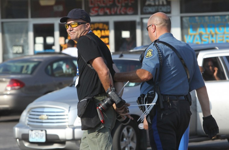 Getty photographer Scott Olson is arrested and taken away on West Florissant Avenue in Ferguson, Mo., on Monday, Aug. 18, 2014. Olson reportedly wasn't crossing the street fast enough for an officer. (J.B. Forbes/St. Louis Post-Dispatch/MCT)