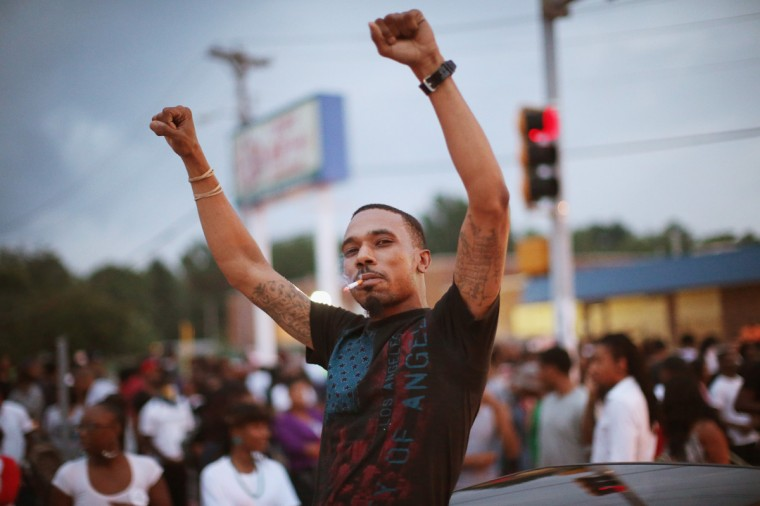 Demonstrators protest the killing of teenager Michael Brown on August 17, 2014 in Ferguson, Missouri. Despite the Brown family's continued call for peaceful demonstrations, violent protests have erupted nearly every night in Ferguson since his death. (Photo by Scott Olson/Getty Images)
