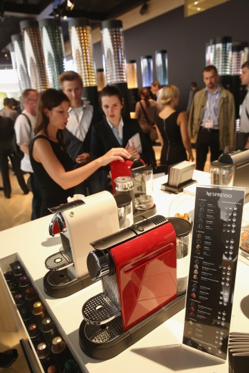 Visitors try espresso coffee at the Nespresso stand at the 2014 IFA home electronics and appliances trade fair on September 5, 2014 in Berlin, Germany. IFA is the world's biggest fair of its kind and is open to the public through September 10. (Sean Gallup/Getty Images)