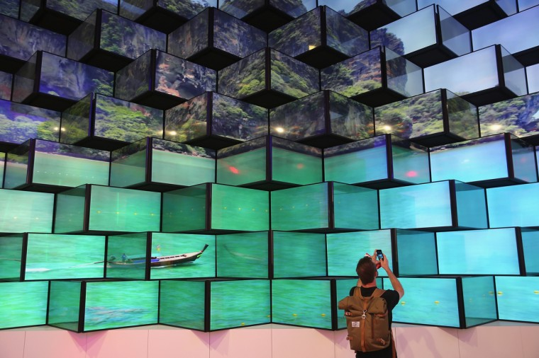 A visitor looks at LED televisions on display at the Vestel stand at the 2014 IFA home electronics and appliances trade fair on September 5, 2014 in Berlin, Germany. IFA is the world's biggest fair of its kind and is open to the public through September 10. (Sean Gallup/Getty Images)