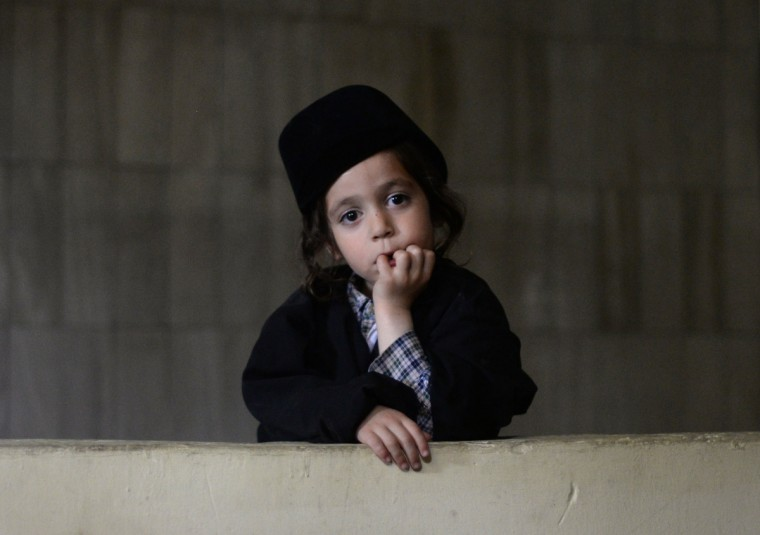 A child, member of an ultra-Orthodox Jewish group, looks on at the building where the group will remain in Guatemala City. 230 ultra-Orthodox Jews were expelled from the town of San Juan La Laguna by Mayan indigenous leaders. (Johan Ordonez/Getty Images)