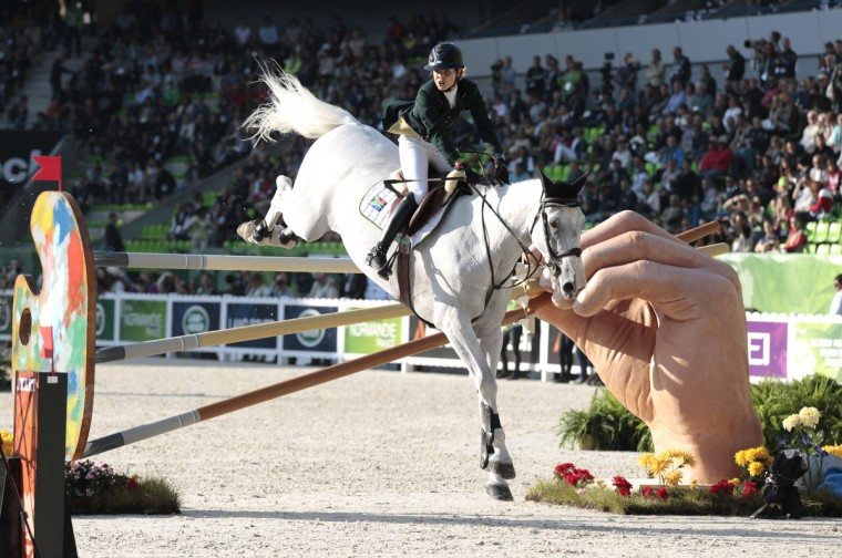 South African Cara Bianca Frew rides Leopold Pierreville during the Individual Jumping competition of the 2014 FEI World Equestrian Games, in the northwestern French city of Caen. (Charly Triballeau/Getty Images)