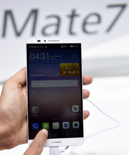 "A Ascend Mate 7 smartphone is displayed at the booth of Chinese multinational networking and telecommunications company Huawei on the opening day of the consumer electronics trade fair ""Internationale Funk Ausstellung ""(IFA) in Berlin. (Tobias Schwarz/AFP/Getty Images)"