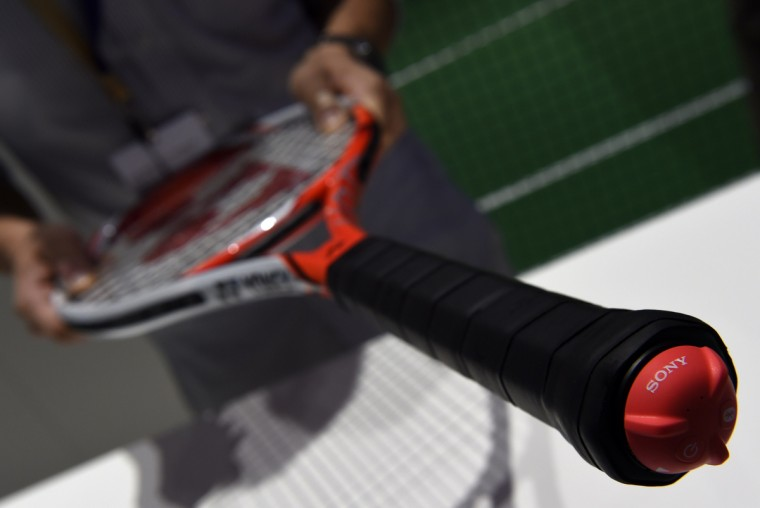 "The Smart Tennis Sensor linking a tennis racket to a smartphone is displayed at the booth of Japanese giant Sony on the opening day of the consumer electronics trade fair ""Internationale Funk Ausstellung ""(IFA) in Berlin September 5, 2014. IFA, one of Europe's biggest showcases of the latest electronic gadgets runs until September 10, 2014. (Tobias Schwarz/AFP/Getty Images)"