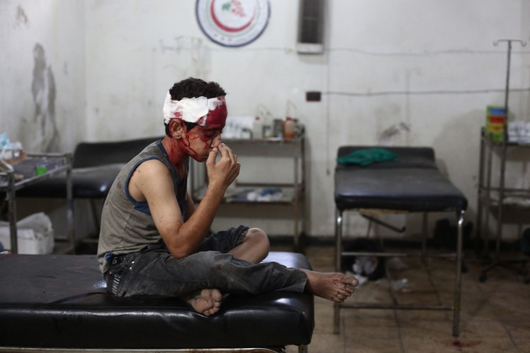 An injured boy sits at a makeshift hospital in the besieged rebel bastion of Douma, northeast of the Syrian capital Damascus following two reported airstrikes by government forces. Some 191,000 people have been killed since an uprising against President Bashar al-Assad's rule erupted in March 2011. (Abd Douamany/Getty Images)