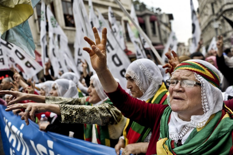 Kurds shout slogan against the Turkish government and the jihadist Islamic State (IS)group during a demonstration on Istiklal avenue in Istanbul. Tens of thousands of Syrian Kurds flooded into Turkey on September 20, fleeing an onslaught by the IS that prompted an appeal for international intervention. (Ozan Kose/Getty Images)