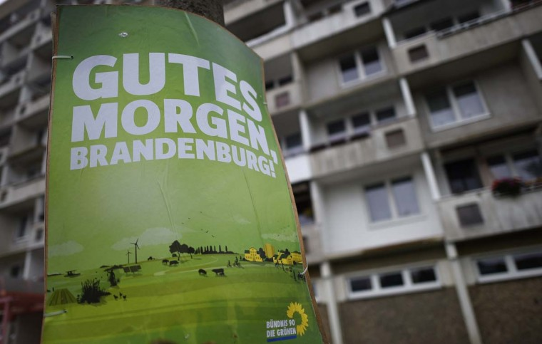 An election poster of the ecological Greens party is pictured next to a concrete building in Cottbus, eastern Germany, September 12. Regional elections will take place in the eastern federal states of Thuringia and Brandenburg on September 14, 2014.      || CREDIT: TOBIAS SCHWARZ - AFP/GETTY IMAGES
