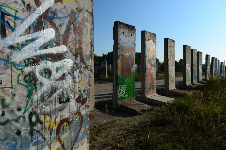 """Cement slabs that used to make up the Berlin wall stand in a vacant lot in Teltow outside of Berlin on September 18, 2014. East Germany's rulers threw up the Berlin Wall in August 1961 to halt a mass exodus of disgruntled citizens turning their backs on the """"workers' paradise"""". (Photos by John MacDougall/AFP/Getty Images)"""