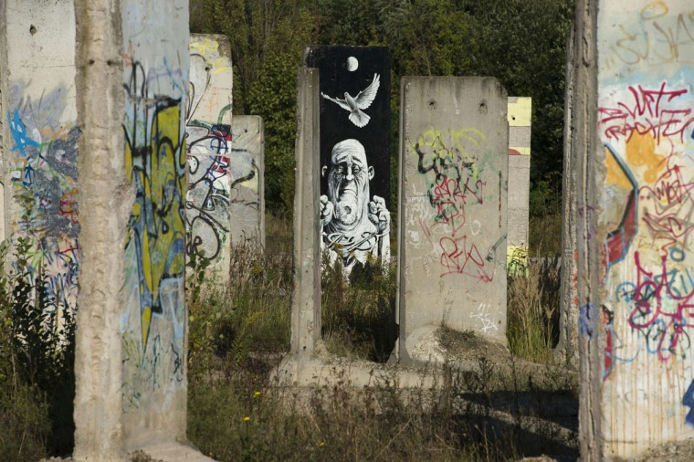 Cement slabs that used to make up the Berlin wall stand in a vacant lot in Teltow outside of Berlin on September 18, 2014. A construction company purchased parts of the wall and offers the possibility to paint them legally after applying for it. (Photos by John MacDougall/AFP/Getty Images)