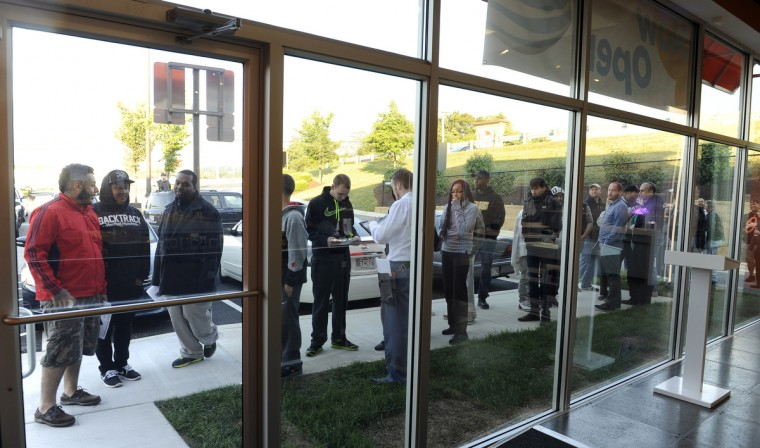 Dozens of people wait in line to buy the new Apple iphone 6 this morning outside the new AT&T store on York Road. Barbara Haddock Taylor/Baltimore Sun