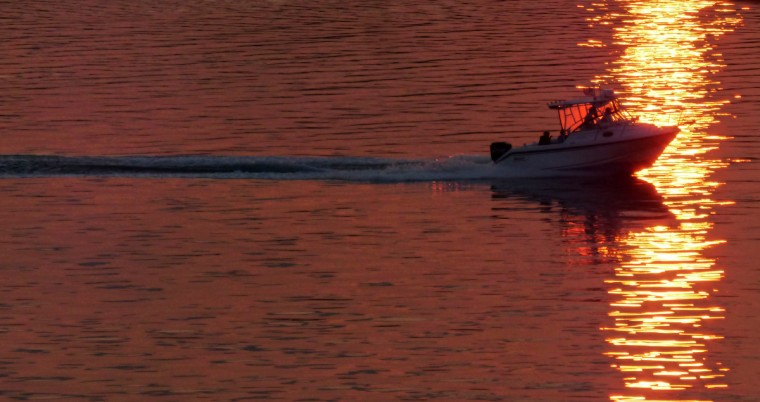 A motor boat heads to Linekin Bay near Ocean Point, Maine as the sun sets. (Karl Merton Ferron/Baltimore Sun)