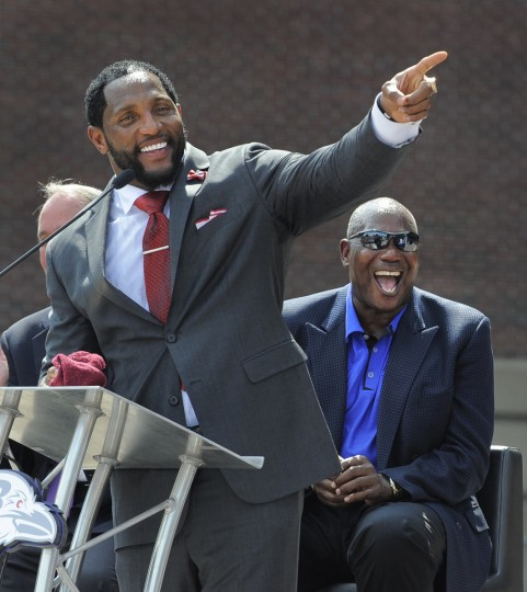 Ray Lewis points to the statue and makes a comment about how he will now never leave Baltimore as Ozzie Newsome can't hold back his laughter. Baltimore Ravens unveil the bronze Ray Lewis statue outside of M&T Bank Stadium. The statue is twelve hundred pounds and stands nine feet tall. Fred Kail was the artist and it took eleven months to make. (Lloyd Fox/Baltimore Sun)